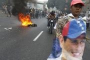A man holds a poster of Henrique Capriles in protest of Maduro's election as president, April 2013.