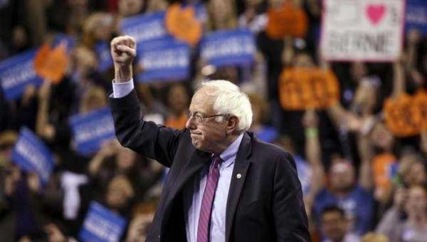 U.S. Democratic presidential candidate Bernie Sanders reacts during a rally.
