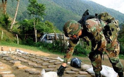 A soldier arranges packets of confiscated cocaine in Colombia's Valle del Cauca province in 2004 in part of the country's longstanding U.S.-backed war on drugs.