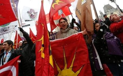 First Nations protesters hold flags during a demonstration as part of the Idle No More movement on Parliament Hill in Ottawa, Canada, Dec. 21, 2012.