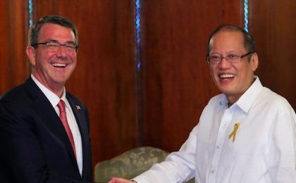 President of the Philippines Benigno Aquino greets visiting U.S. Defense Secretary Ash Carter at the presidential palace in Manila April 14, 2016.
