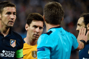 Atletico Madrid's midfielder Gabi (L) and Barcelona's Argentinian forward Lionel Messi look at Italian referee Nicola Rizzoli (2nd R) April 13, 2016.