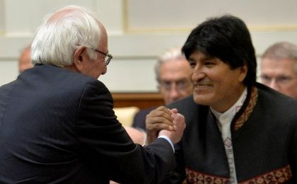 U.S. Democratic presidential candidate Bernie Sanders (L) shakes hands with Bolivia's president Evo Morales (R) during a conference at the Vatican , April 15, 2016.