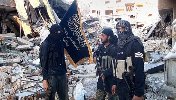 Fighters from the Al-Nusra Front near the front line with Syrian government solders in Yarmuk