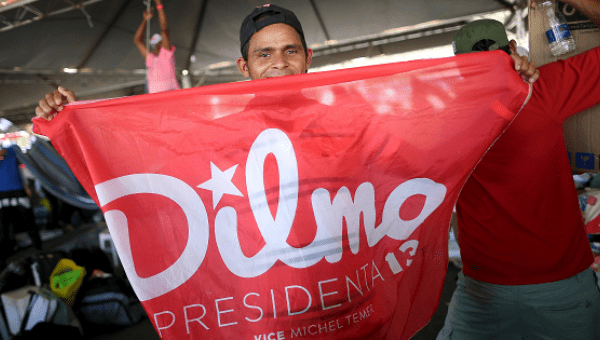 A member of the Landless Workers Movement (MST) shows a flag in support of Brazil