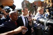 South African Olympic and Paralympic sprinter Oscar Pistorius (C) leaves the North Gauteng High Court in Pretoria after a brief appearance, April 18, 2016.