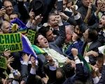 Right-wing members of the lower house of Congress celebrate after the vote to impeach President Dilma Rousseff wins, April 17, 2016.