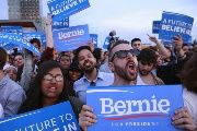 People cheer as they listen to U.S. presidential candidate Bernie Sanders speak at a campaign rally in the Queens borough of New York, U.S., April 18, 2016.