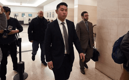 New York police officer Peter Liang arrives at a courtroom in Brooklyn, New York. He is charged with second-degree manslaughter over the death of Akai Gurley.
