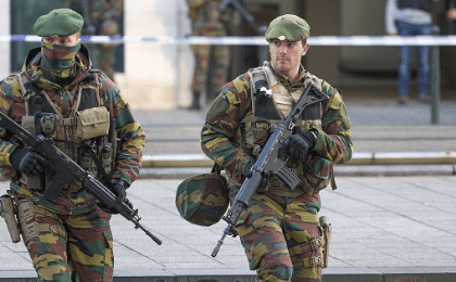 A Belgian special forces police officer and soldiers secure the zone outside a courthouse, while Brussels attacks suspects Mohamed Abrini and Osama Krayem appear before a judge, in Brussels, Belgium, April 14, 2016.