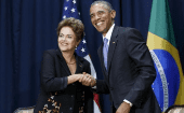 U.S. President Barack Obama shakes hands with Brazil's President Dilma Rousseff at their meeting during the Summit of the Americas in Panama City, Panama April 11, 2015.