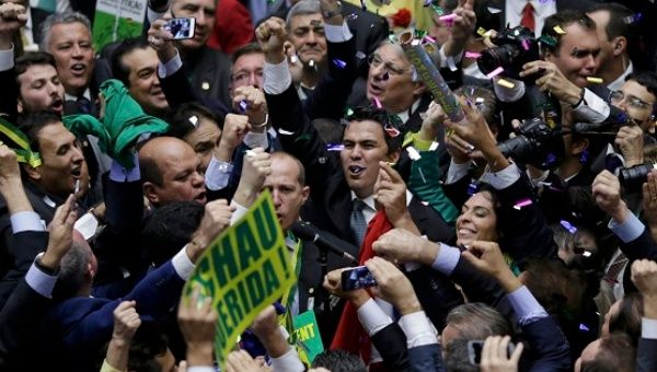 Members of the Lower House of Congress celebrate after they voted in favor of the impeachment of President Dilma Rousseff in Brasilia, Brazil April 17, 2016.