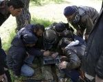 Rebel fighters work on a computer to determine their target points ahead of an offensive Syrian army at the frontline of Idlib city in northern Syria. Picture taken March 23, 2015.