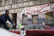 A banner hangs on a squatter house in Berlin, Germany, April 13, 2016. The words read 'Against repression in Turkey! Solidarity with Kurdish resistance'.