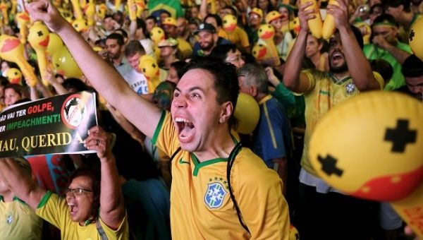 Demonstrators react to the vote for President Dilma Rousseff