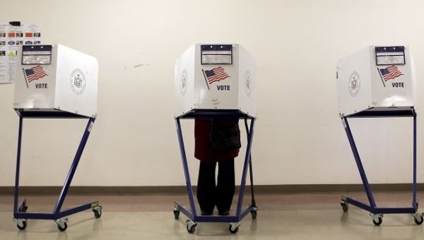 A voter is seen at a polling station during the New York primary elections in the Manhattan borough of New York.