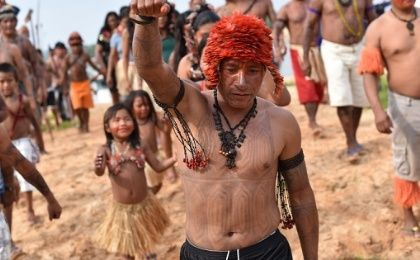 Munduruku warriors of Brazil and their children head for Sao Luiz do Tapajos to express their deep dissent with a mega-dam project.