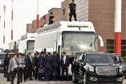 Security officers protect a bus prepared for German Chancellor Merkel, Turkish Prime Minister Davutoglu, EU Council President Tusk and European Commission Vice-President Timmermans at Gaziantep airport.