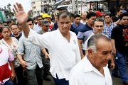 President of Ecuador,  Rafael Correa, walks in the city of Pedernales after the 7.8 earthquake left death and destruction, April, 22. 2016.