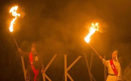 Members of the Rebel Brigade Knights and the Nordic Order Knights, groups that both claim affiliation with the Ku Klux Klan, hold their lit torches during a cross-lighting ceremony at a private residence in Henry County, Virginia, Oct. 11, 2014