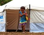 A young girl walks through a refuge shelter for earthquake victims in Ecuador, April 24, 2016.