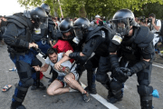 Hungarian riot police fight migrants at the border crossing with Serbia in Roszke, Hungary Sept. 16, 2015.