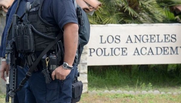 File picture shows police officers standing guard at the entrance to the Los Angeles Police Academy.
