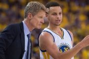 Golden State Warriors head coach Steve Kerr talks to guard Stephen Curry during a game.