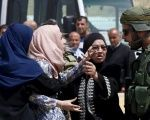 A Palestinian woman argues with an Israeli policeman near the scene of the shooting by Israeli police near Qalandia checkpoint, April 27, 2016.