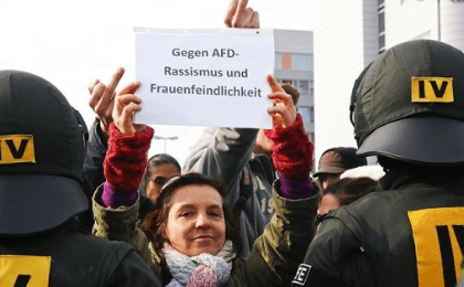 Anti-AfD protestors hold a banner reading 'Against AfD racism and misogyny' during the AfD party congress in Stuttgart, Germany, April 30, 2016.