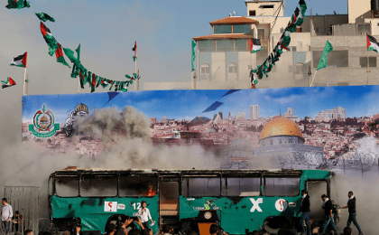 A mock burnt Israeli bus is seen on a stage during an anti-Israel rally organised by Palestinian Hamas movement in Gaza city April 28, 2016.
