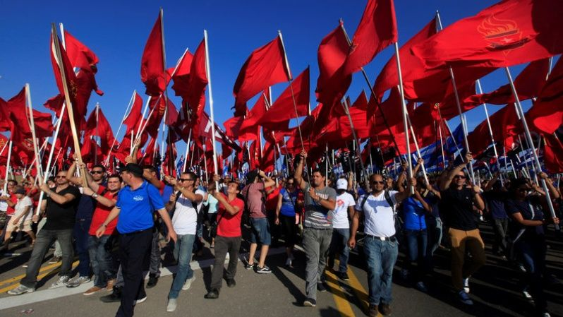 Members of the Young Communist Movement wave red flags in Havana.