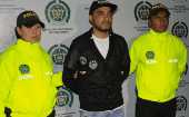 Picture by the Colombian police of Peruvian drug traffiker Gerson Galvez, aka Caracol (C), as he is escorted by the narcotics police at the Bogota airport on May 1, 2016