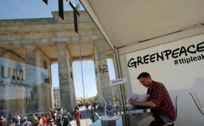 A man reads a copy of the leaked TTIP negotiations inside a public reading room by the environmental campaign group Greenpeace in front of the Brandenburg Gate in Berlin, Germany, May 2, 2016.