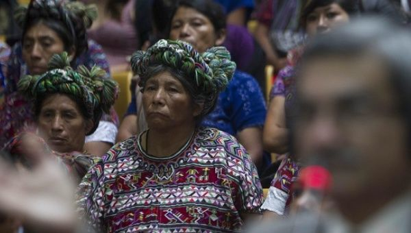 Ixil women listen to testimonies during the genocide trial against former dictator Efrain Rios Montt in Guatemala City, May 10, 2013.
