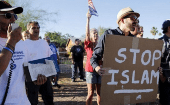 "A demonstrator shouts and carries a ""Stop Islam"" sign during a ""Freedom of Speech Rally Round II"" outside the Islamic Community Center of Phoenix, Arizona on May 29, 201"