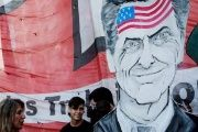 A caricature of President Macri with the U.S. flag on his forehead at a protest in Argentina.
