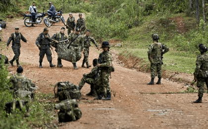 Colombian soldiers after clashes with the Revolutionary Armed Forces of Colombia (FARC) guerrillas, in the rural area of Buenos Aires, department of Cauca, Colombia, on April 15, 2015