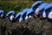 Guatemalan soldiers listen to a speech by President Jimmy Morales during a ceremony at Campo Marte in Guatemala City, on Jan. 15, 2016.