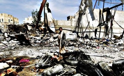 A Yemeni man walks amid the rubble of a food storage warehouse after it was targeted by air strikes carried out by the Saudi-led coalition in the capital Sanaa.