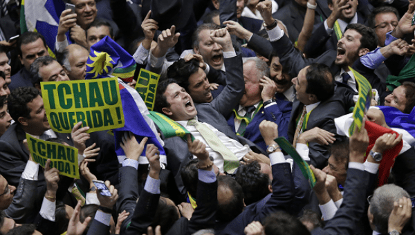 Bruno Araujo (C) celebrates after his vote in favor of the impeachment of President Dilma Rousseff was enough to confirm the process, in Brasilia.