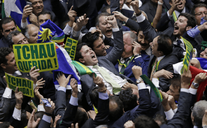Member of the Lower House of Congress, Bruno Araujo (C) celebrates with fellow congressmen after his vote in favor of the impeachment of President Dilma Rousseff was enough to confirm the process, in Brasilia.