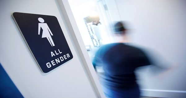 A bathroom sign welcomes both genders at the Cacao Cinnamon coffee shop in Durham, North Carolina, May 3, 2016.