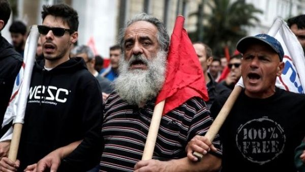 Members of the communist-affiliated PAME union shout slogans during a 48-hour general strike against tax and pension reforms in Athens, Greece, May 6, 2016.