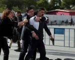 An assailant who attempted to shoot Turkish journalist Can Dundar is caught by his wife Dilek Dundar and an unidentified man at a courthouse in Istanbul, Turkey May 6, 2016.