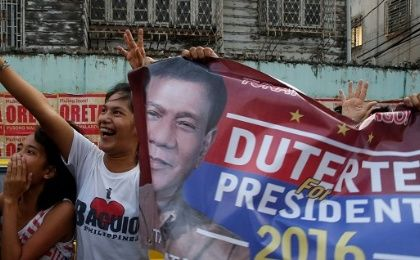 Supporters chant slogans as the motorcade of presidential candidate Rodrigo Duterte passes.