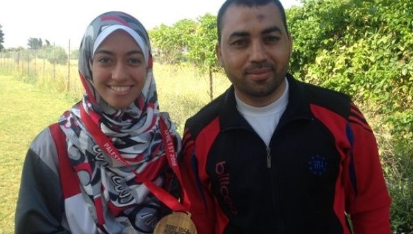 Inas Nofal with her coach Sami Nateel.
