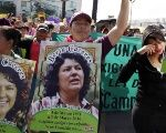 Activists demand an independent investigation into the murder of Berta Caceres.