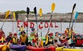 Up to 200 protesters paddled in kayaks into Newcastle Harbour at 11am on Saturday to impede the path of coal ships arriving and leaving the city for the remainder of the day