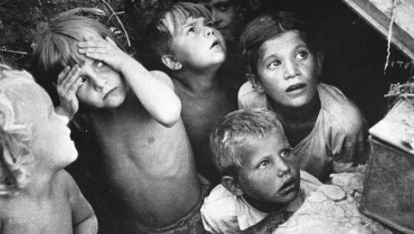 Children in Stalingrad hiding from bombing by German planes in a 1942 photo taken by L.I. Konov.